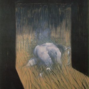 Man kneeling in grass
